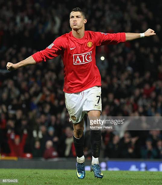 Cristiano Ronaldo of Manchester United celebrates scoring their fifth goal during the Barclays Premier League match between Manchester United and...