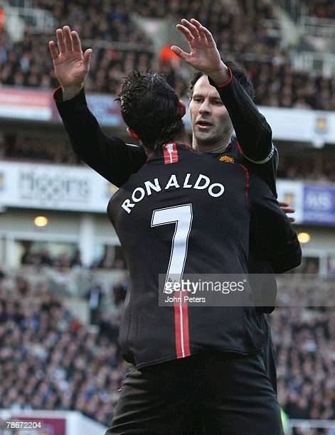 Cristiano Ronaldo of Manchester United celebrates scoring their first goal with team mate Ryan Giggs during the Barclays FA Premier League match...