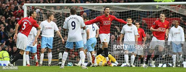 Cristiano Ronaldo of Manchester United celebrates scoring their first goal during the Barclays FA Premier League match between Manchester United and...