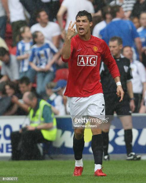 Cristiano Ronaldo of Manchester United celebrates scoring their first goal from the penalty spot during the Barclays FA Premier League match between...