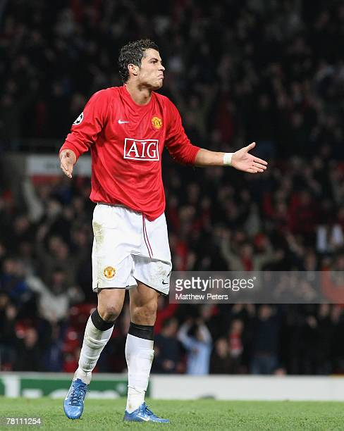 Cristiano Ronaldo of Manchester United celebrates scoring their second goal during the UEFA Champions League match between Manchester United and...