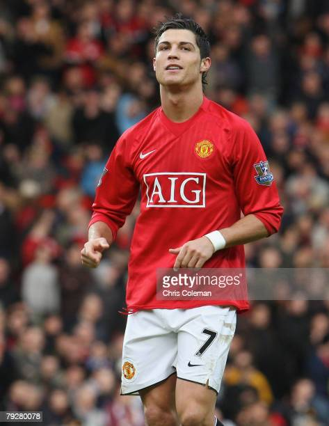 Cristiano Ronaldo of Manchester United celebrates scoring their second goal during the FA Cup sponsored by e.on Fourth Round match between Manchester...
