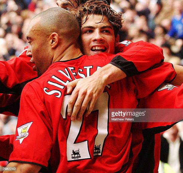 Cristiano Ronaldo of Manchester United celebrates scoring their third goal with Mikael Silvestre during the AXA FA Cup match between Manchester...