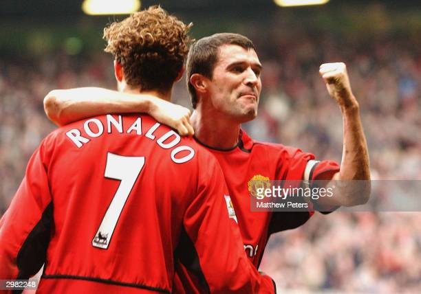 Cristiano Ronaldo of Manchester United celebrates scoring their third goal with Roy Keane during the AXA FA Cup match between Manchester United and...