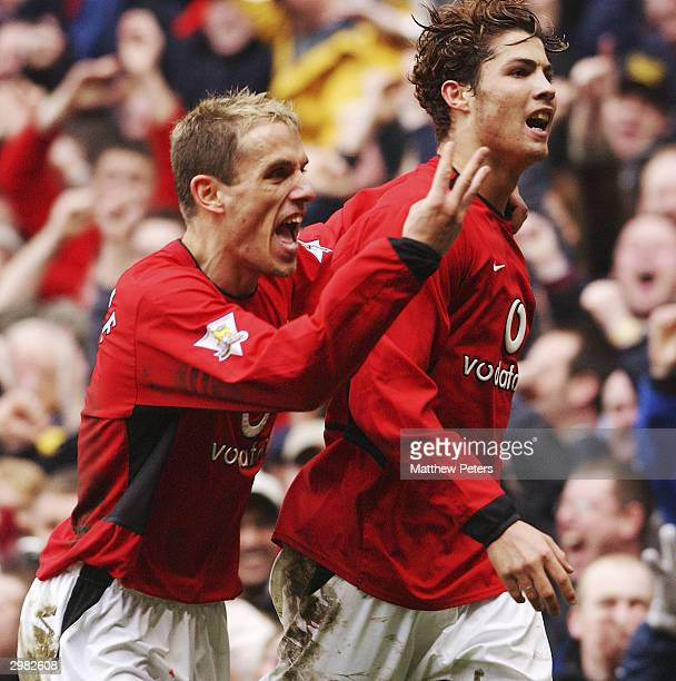 Cristiano Ronaldo of Manchester United celebrates scoring their third goal with Phil Neville during the AXA FA Cup match between Manchester United...