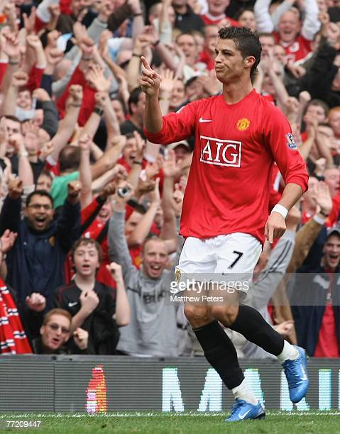 Cristiano Ronaldo of Manchester United celebrates scoring their third goal during the Barclays FA Premier League match between Manchester United and...
