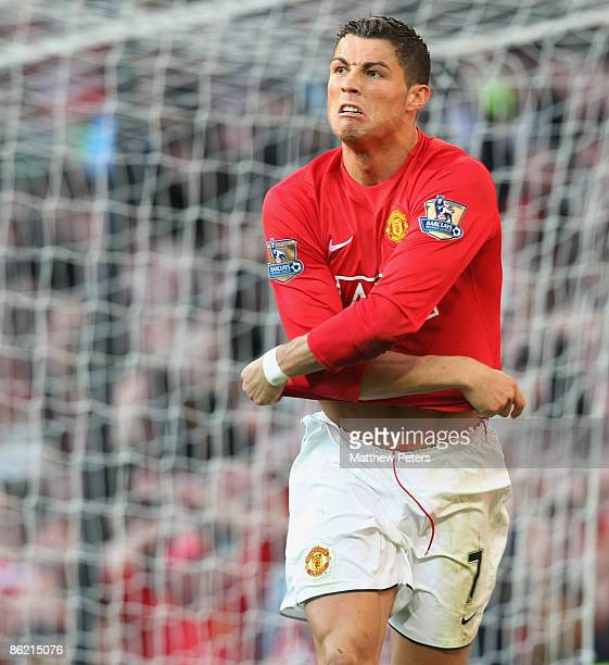 Cristiano Ronaldo of Manchester United celebrates scoring their third goal during the Barclays Premier League match between Manchester United and...