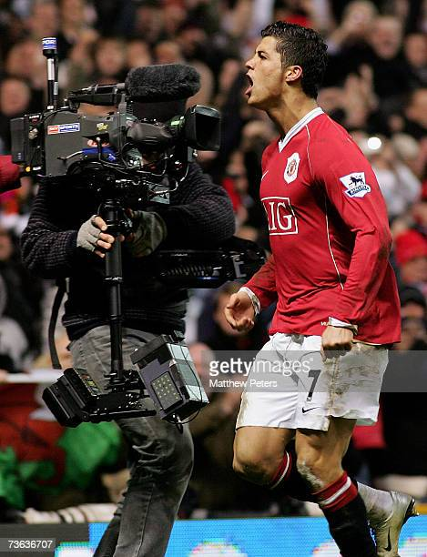 Cristiano Ronaldo of Manchester United celebrates scoring United's first goal during the FA Cup sponsored by EON QuarterFinal Replay match between...