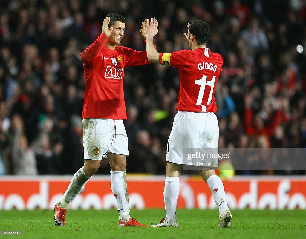Cristiano Ronaldo of Manchester United celebrates with team mate Ryan Giggs at the end of the UEFA Champions League Round of Sixteen, Second Leg match between Manchester United and Inter Milan at Old Trafford on March 11, 2009 in Manchester, England.