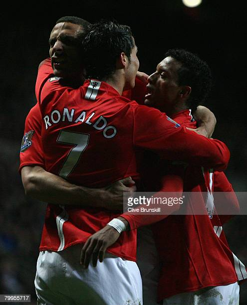 Cristiano Ronaldo of Manchester United celebrates with team mates Rio Ferdinand and Nani after scoring his team's third goal during the Barclays...