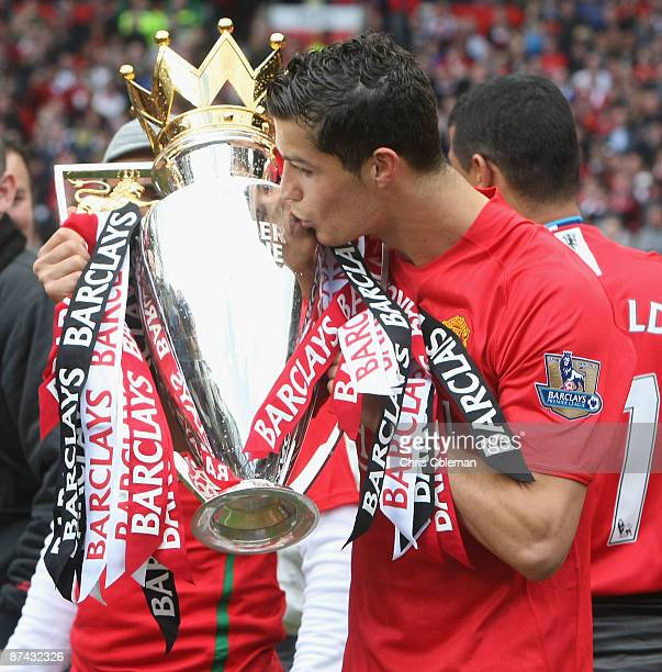Cristiano Ronaldo of Manchester United celebrates with the Premier League trophy after the Barclays Premier League match between Manchester United...