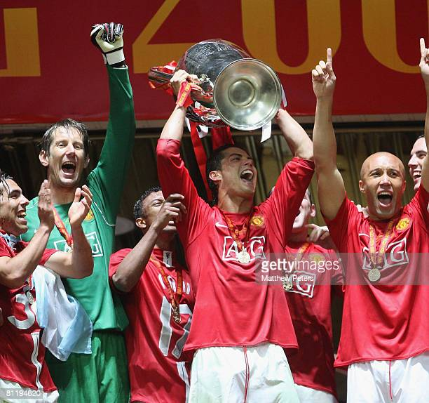 Cristiano Ronaldo of Manchester United celebrates with the trophy after winning the UEFA Champions League Final match between Manchester United and...