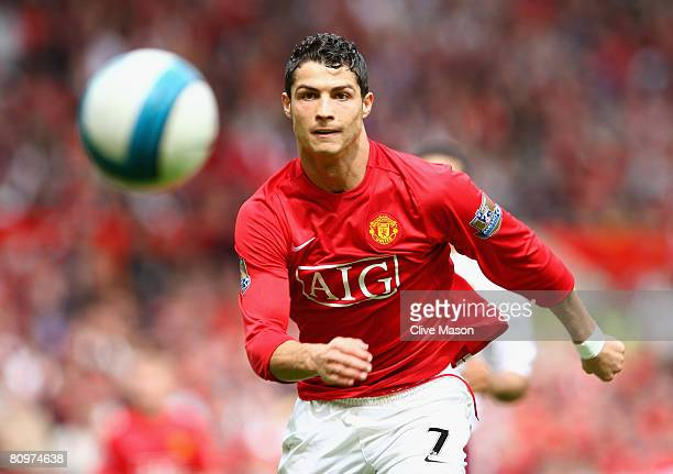 Cristiano Ronaldo of Manchester United chases the ball during the Barclays Premier League match between Manchester United and West Ham United at Old...