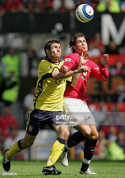 Cristiano Ronaldo of Manchester United clashes with Aaron Hughes of Aston Villa during the Barclays Premiership match between Manchester United and...