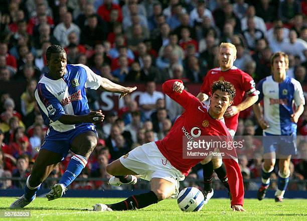 Cristiano Ronaldo of Manchester United clashes with Aaron Mokoena of Blackburn Rovers during the Barclays Premiership match between Manchester United...
