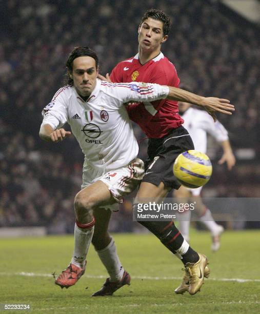Cristiano Ronaldo of Manchester United clashes with Alessandro Nesta during the UEFA Champions League match between Manchester United and AC Milan at...