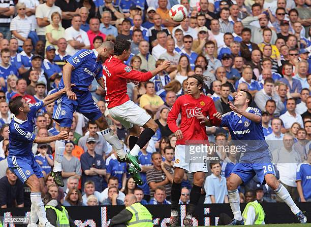 Cristiano Ronaldo of Manchester United clashes with Alex of Chelsea during the FA Premier League match between Chelsea and Manchester United at...