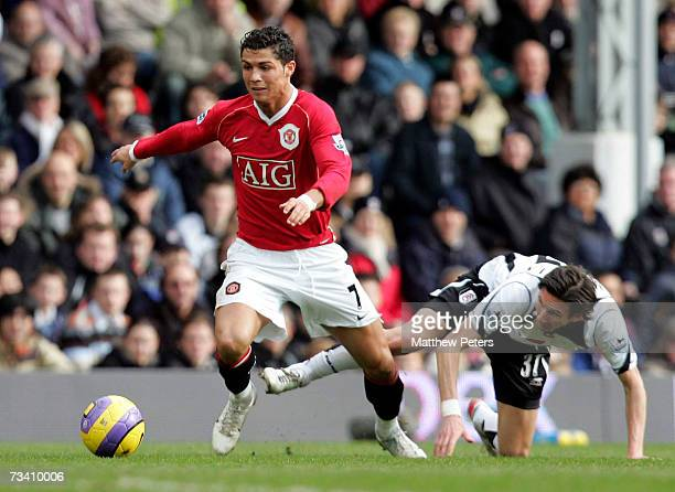 Cristiano Ronaldo of Manchester United clashes with Alexei Smertin of Fulham during the Barclays Premiership match between Fulham and Manchester...