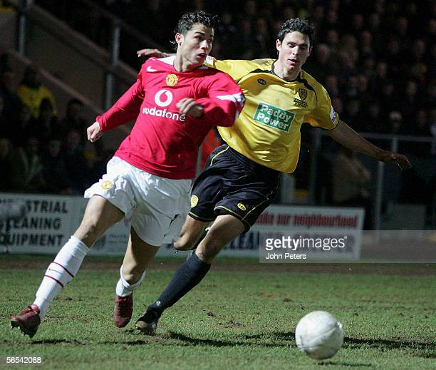 Cristiano Ronaldo of Manchester United clashes with Andrew Corbett of Burton Albion during the FA Cup Third Round match between Burton Albion and...