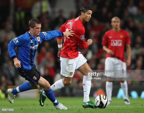 Cristiano Ronaldo of Manchester United clashes with Andrew Taylor of Middlesbrough during the Carling Cup third round match between Manchester United...