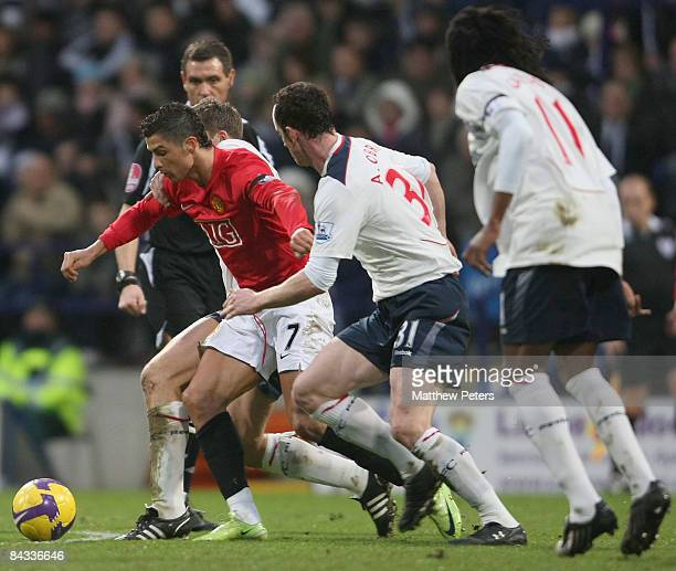 Cristiano Ronaldo of Manchester United clashes with Andy O'Brien of Bolton Wanderers during the Barclays Premier League match between Bolton...