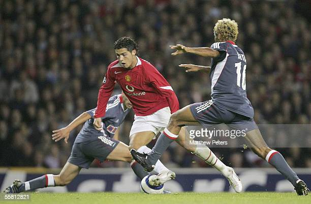Cristiano Ronaldo of Manchester United clashes with Beto of Benfica during the UEFA Champions League match between Manchester United and Benfica at...