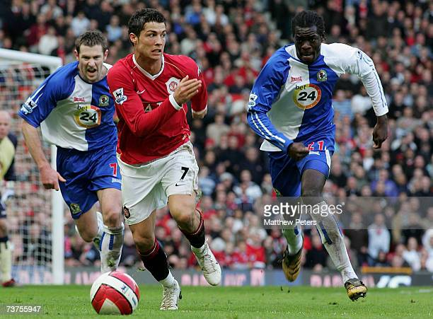 Cristiano Ronaldo of Manchester United clashes with Brett Emerton and Cristopher Samba of Blackburn Rovers during the Barclays Premiership match...