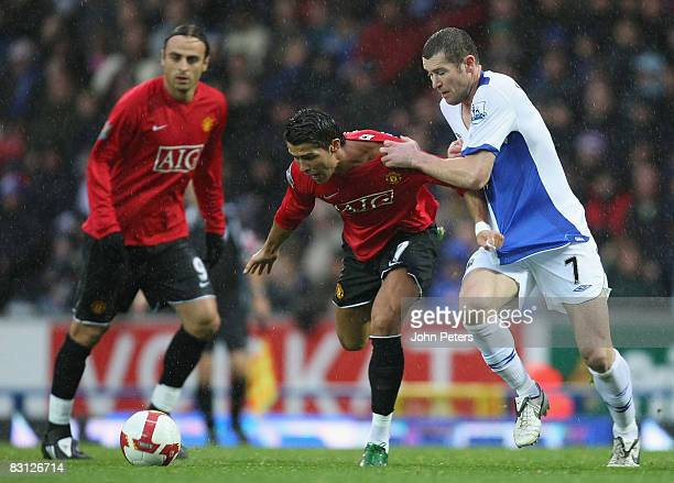 Cristiano Ronaldo of Manchester United clashes with Brett Emerton of Blackburn Rovers during the FA Premier League match between Blackburn Rovers and...