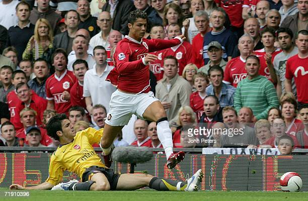 Cristiano Ronaldo of Manchester United clashes with Cesc Fabregas of Arsenal during the Barclays Premiership match between Manchester United and...