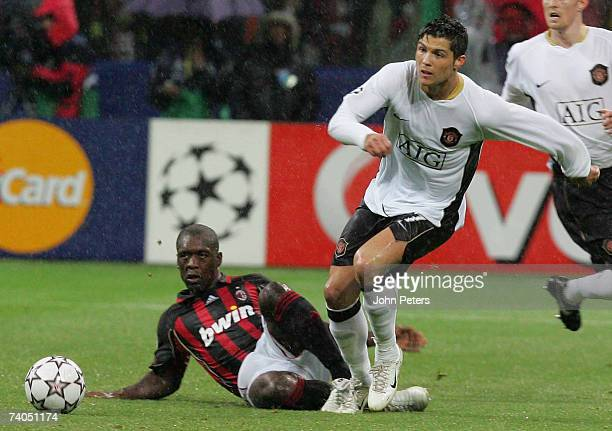 Cristiano Ronaldo of Manchester United clashes with Clarence Seedorf of AC Milan during the UEFA Champions League SemiFinal Second Leg match between...