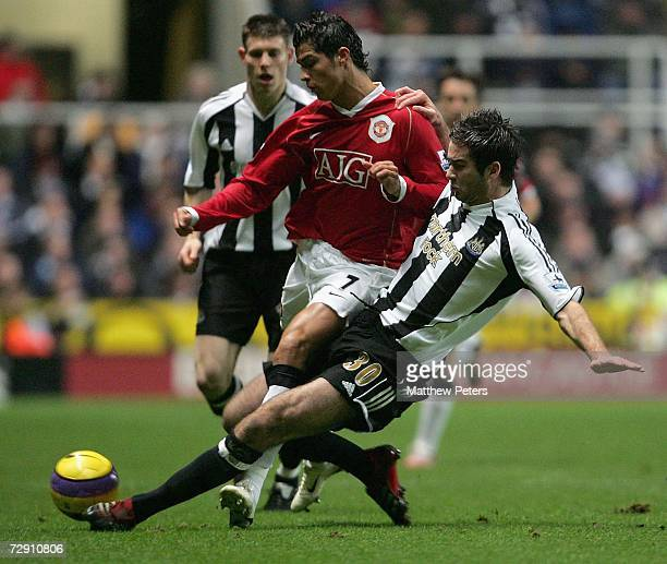 Cristiano Ronaldo of Manchester United clashes with David Edgar of Newcastle United during the Barclays Premiership match between Newcastle United...