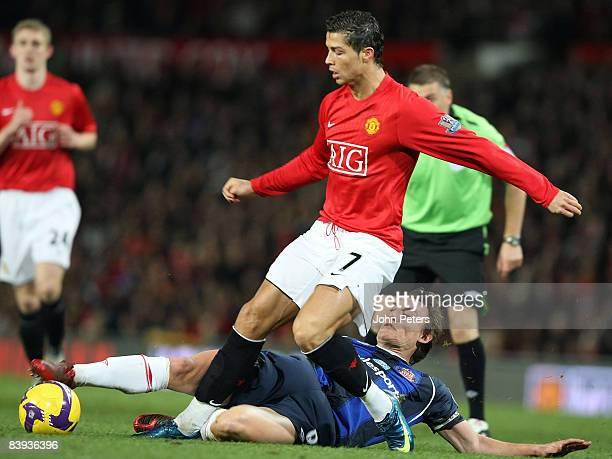 Cristiano Ronaldo of Manchester United clashes with Dean Whitehead of Sunderland during the Barclays Premier League match between Manchester United...