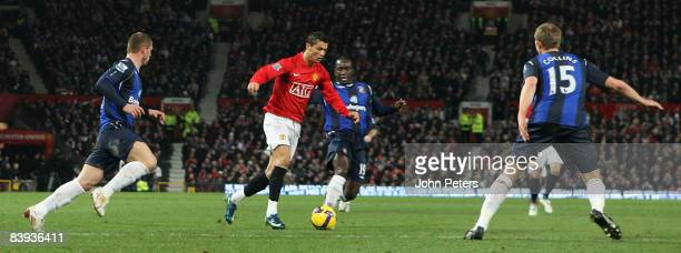 Cristiano Ronaldo of Manchester United clashes with Dwight Yorke of Sunderland during the Barclays Premier League match between Manchester United and...