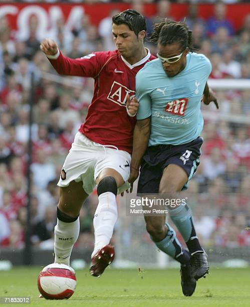 Cristiano Ronaldo of Manchester United clashes with Edgar Davids of Tottenham Hotspur during the Barclays Premiership match between Manchester United...