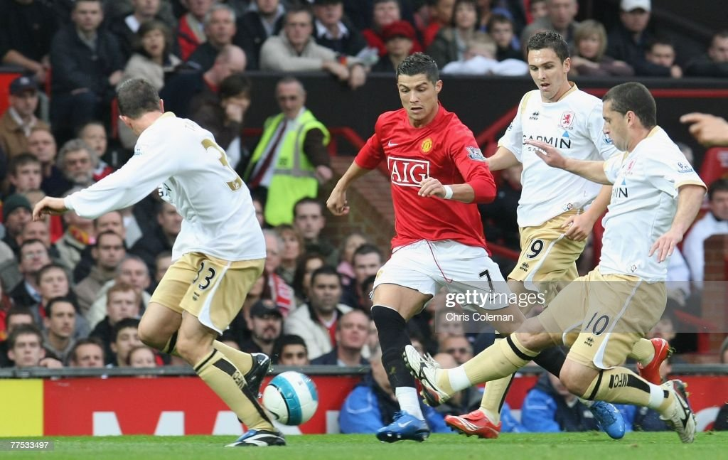 Cristiano Ronaldo of Manchester United clashes with Fabio Rochemback of Middlesbrough during the Barclays FA Premier League match between Manchester United and Middlesbrough at Old Trafford on October 27 2007 in Manchester, England.