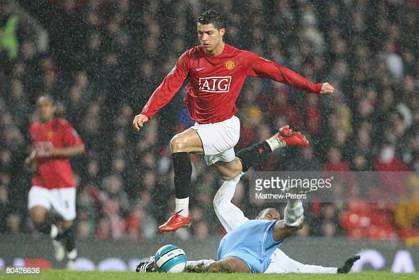 Cristiano Ronaldo of Manchester United clashes with Gabriel Agbonlahor of Aston Villa during the Barclays FA Premier League match between Manchester...