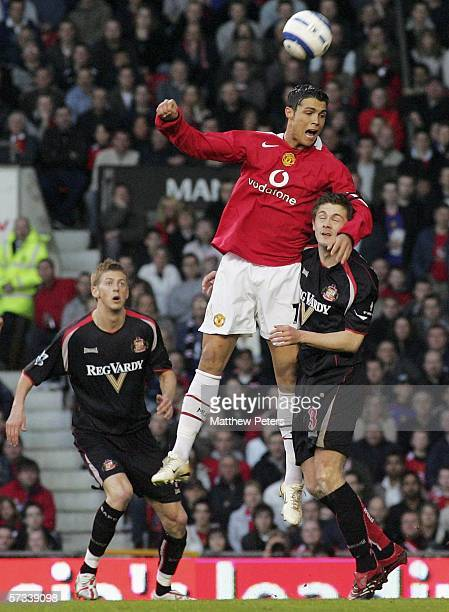 Cristiano Ronaldo of Manchester United clashes with George McCartney of Sunderland during the Barclays Premiership match between Manchester United...