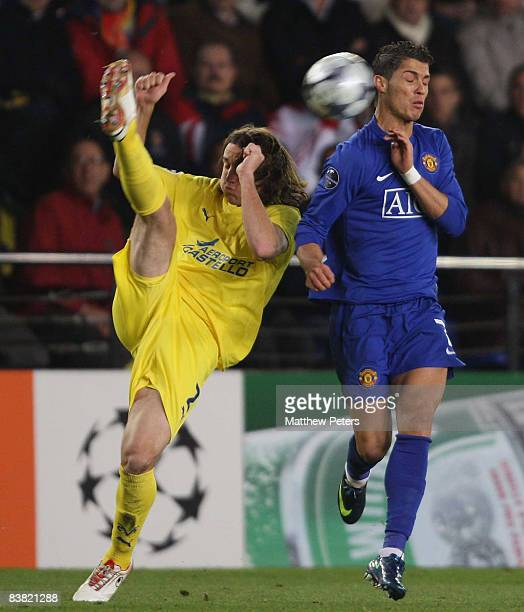Cristiano Ronaldo of Manchester United clashes with Gonzalo Rodriguez of Villarreal during the UEFA Champions League Group E game between Villarreal...