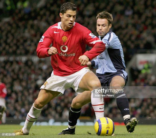 Cristiano Ronaldo of Manchester United clashes with Graeme Le Saux of Southampton during the Barclays Premiership match between Manchester United and...