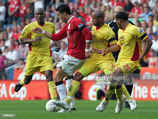 Cristiano Ronaldo of Manchester United clashes with James Chambers of Watford during the FA Cup sponsored by E.ON Semi-final match between Watford...
