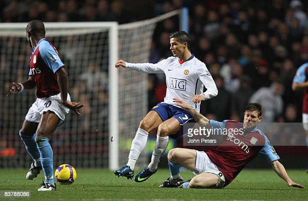Cristiano Ronaldo of Manchester United clashes with James Milner of Aston Villa during the Barclays Premier League match between Aston Villa and...