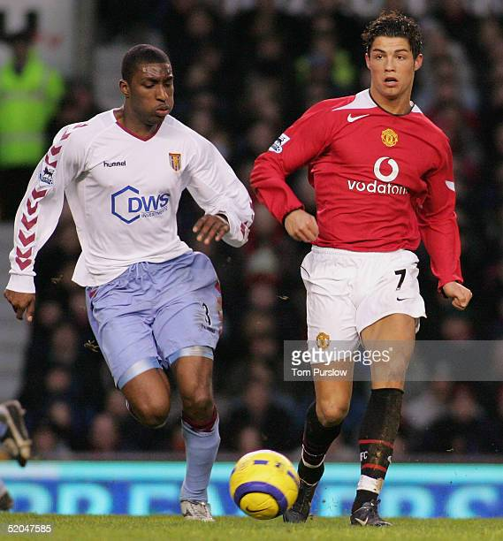Cristiano Ronaldo of Manchester United clashes with Jlloyd Samuel of Aston Villa during the Barclays Premiership match between Manchester United and...
