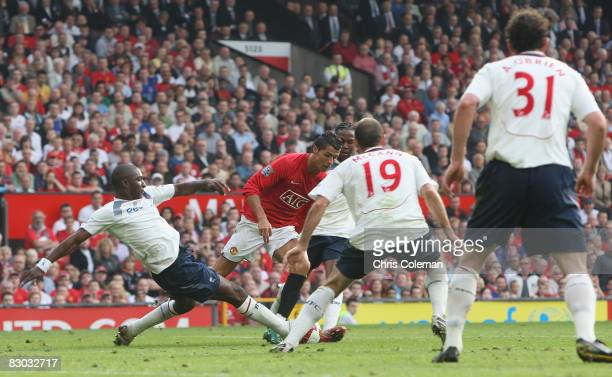 Cristiano Ronaldo of Manchester United clashes with Jlloyd Samuel which led to a penalty during the FA Premier League match between Manchester United...