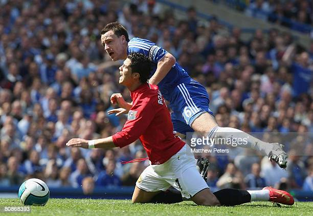 Cristiano Ronaldo of Manchester United clashes with John Terry of Chelsea during the Barclays FA Premier League match between Chelsea and Manchester...