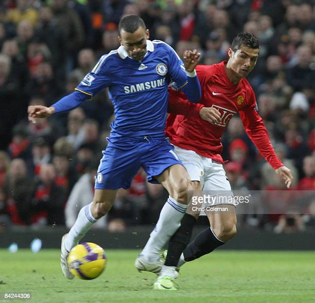 Cristiano Ronaldo of Manchester United clashes with Jose Bosingwa of Chelsea during the Barclays Premier League match between Manchester United and...