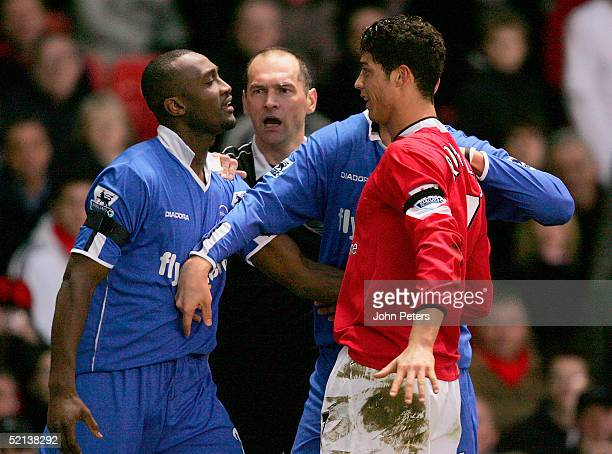 Cristiano Ronaldo of Manchester United clashes with Julian Gray of Birmingham City during the Barclays Premiership match between Manchester United...