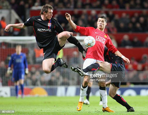 Cristiano Ronaldo of Manchester United clashes with Kim Kallstrom of Olympique Lyonnais during the UEFA Champions League first knockout round match...