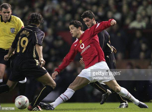 Cristiano Ronaldo of Manchester United clashes with Kwarme Ampadu and Scott Hiley of Exeter City during the FA Cup third round match between...