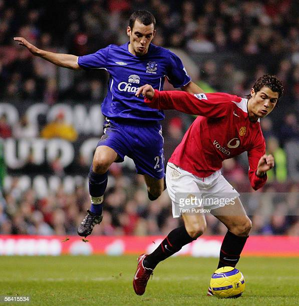 Cristiano Ronaldo of Manchester United clashes with Leon Osman of Everton during the Barclays Premiership match between Manchester United and Everton...