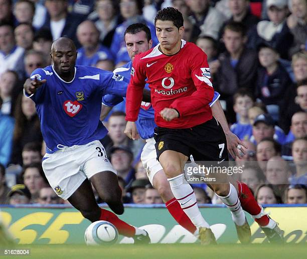 Cristiano Ronaldo of Manchester United clashes with Lomana Tresor Lualua of Portsmouth during the Barclays Premiership match between Portsmouth and...
